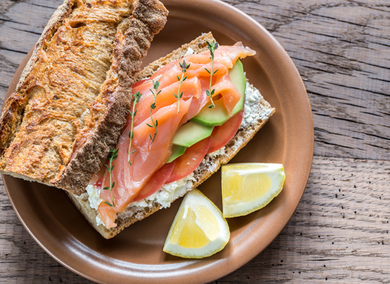 Smoked salmon and avocado sandwich on a crusty baguette - Recipe